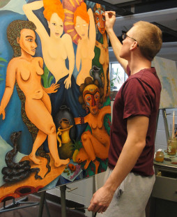 Student Josh Gove painting on canvas.