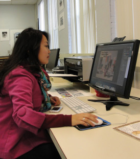 Student Taylor McLane in the graphic design studio. This studio space is in the upstairs of Clack...