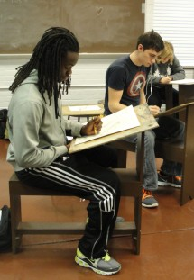 Students learning drawing techniques in the life drawing course in the Clack Art Center.