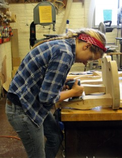 Student Amy Merriman working diligently in the woodshop on her custom chairs for her senior show.