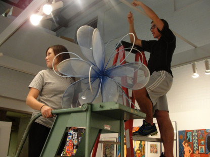 Students Josh and Carolyn installing a show in the Flora Kirsch Beck Art Gallery, the only profes...