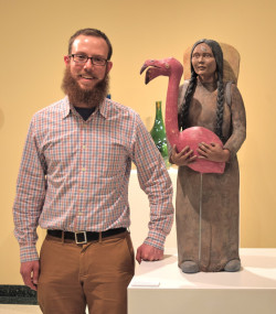 "Benjamin with his Ceramic Sculpture, ""Bird Woman"