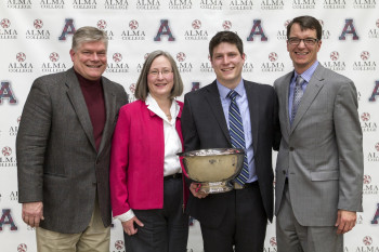 Michael Reeves (third from left), with parents Mark and Laura Reeves and Alma President Jeff Abernathy.