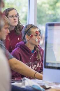 Chelsea Mertz '14 participate in a health lab doing eye exam testing