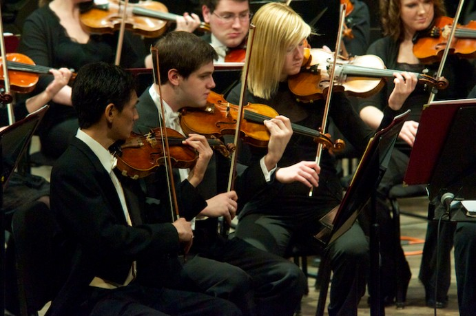 Orchestra students performing.