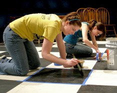 Emily and Hillary painting the floor.