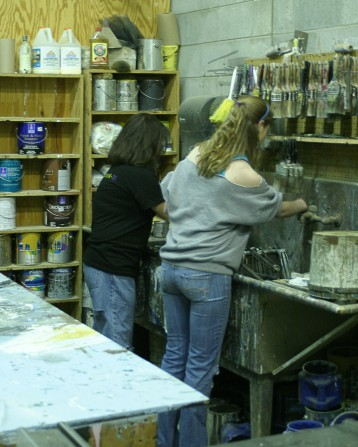 The Scene Shop – Nati & Lauren cleaning paint brushes.