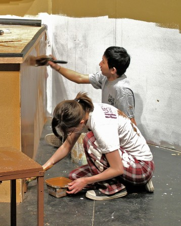 Hillary and Matt painting the set.