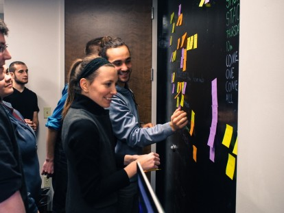 Brainstorming the annual New Media Studies senior show the best way we know how — with sticky notes.