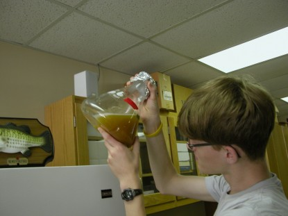 Jacob Lambrecht '15 measuring liquids in the lab.