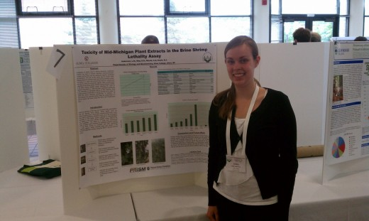 Student presenting her research during a poster presentation.