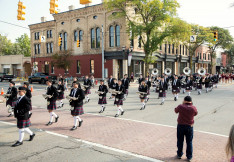 Kiltie Marching Band in front of Wright Leppien Opera House Homecoming 2019