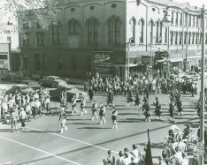 Alma  marching band in front of Wright Leppien Opera House Homecoming Parade 1953