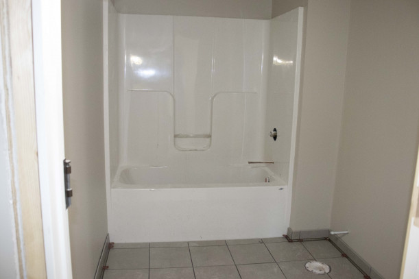 Bathroom with shower and tiling