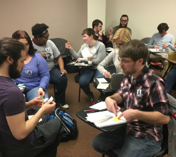 Cultural Anthropology students perform an economic simulation in class.