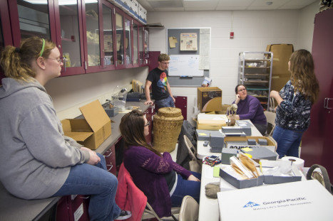 Students and faculty discuss current projects in the Anthropology lab.