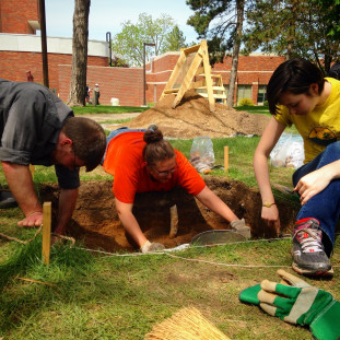 Anthropology Majors Steven Fischer ('16), Ashleigh Strand ('17) and Allison Smith (/17) excavate a test unit at the site of the Old Main Building on campus.