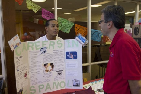 Students offer displays during Fiesta Baile in Hispanic Heritage Month.