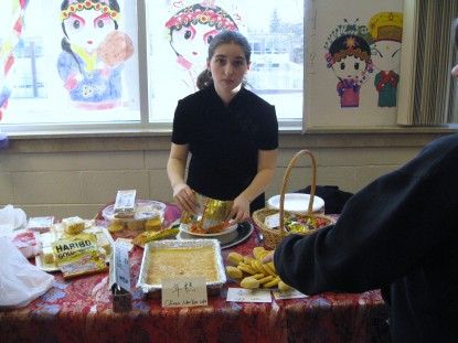 Alicia Monday was the President of the Chinese Club and hosted the Chinese presentation at the de...