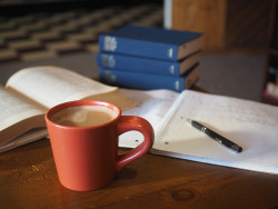 Coffee and on table with notebooks
