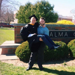 Joonas Kotka in front of the Alma College sign.
